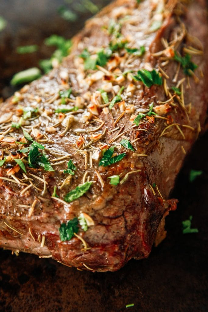 a close up of the seasoning on Oven Baked Garlic Rosemary London Broil.