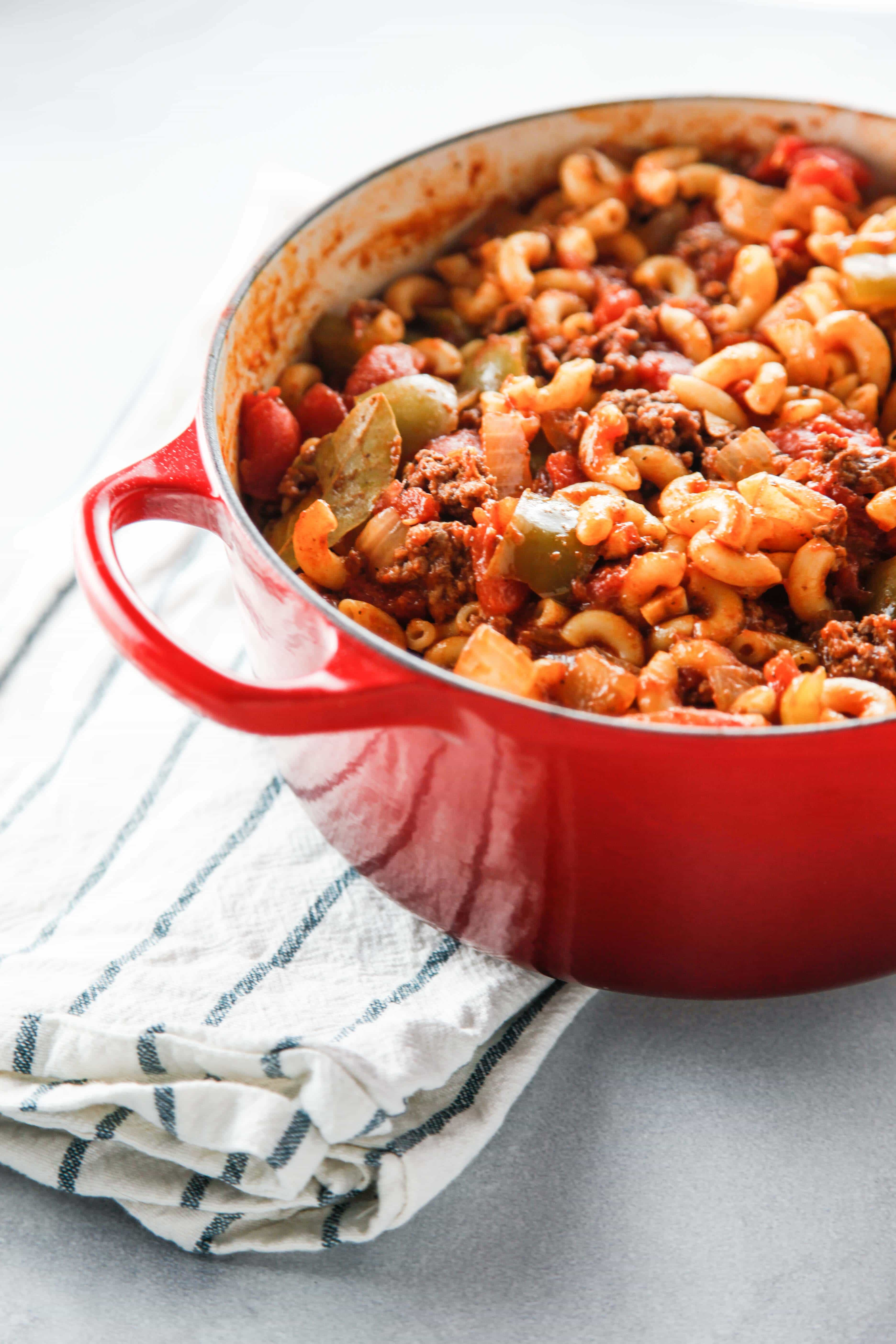 a red dutch oven full of Easy Saucy American Goulash.