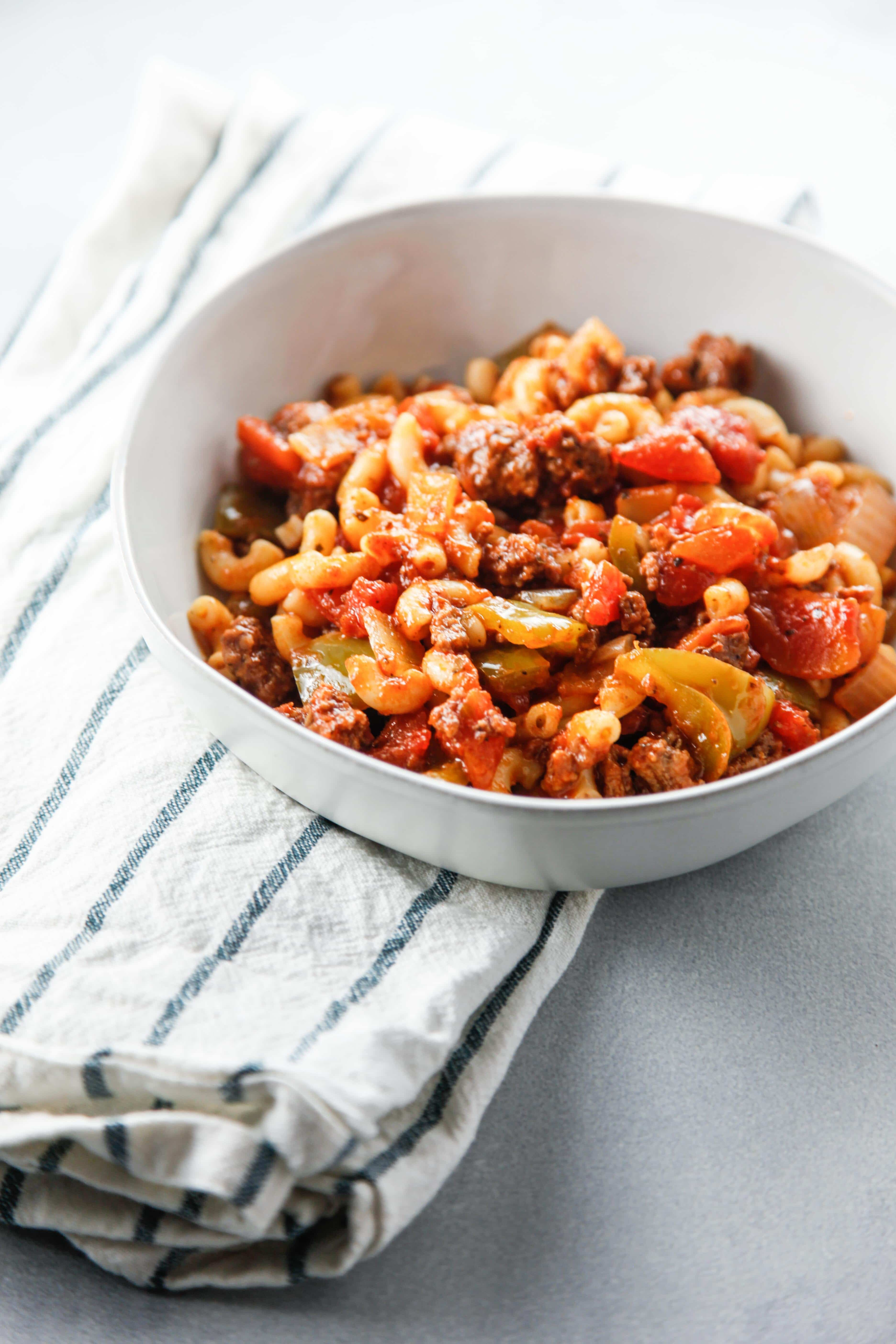 a white bowl full of Easy Saucy American Goulash.