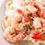 pinterest image for Garlicky Shrimp Fettuccine Alfredo