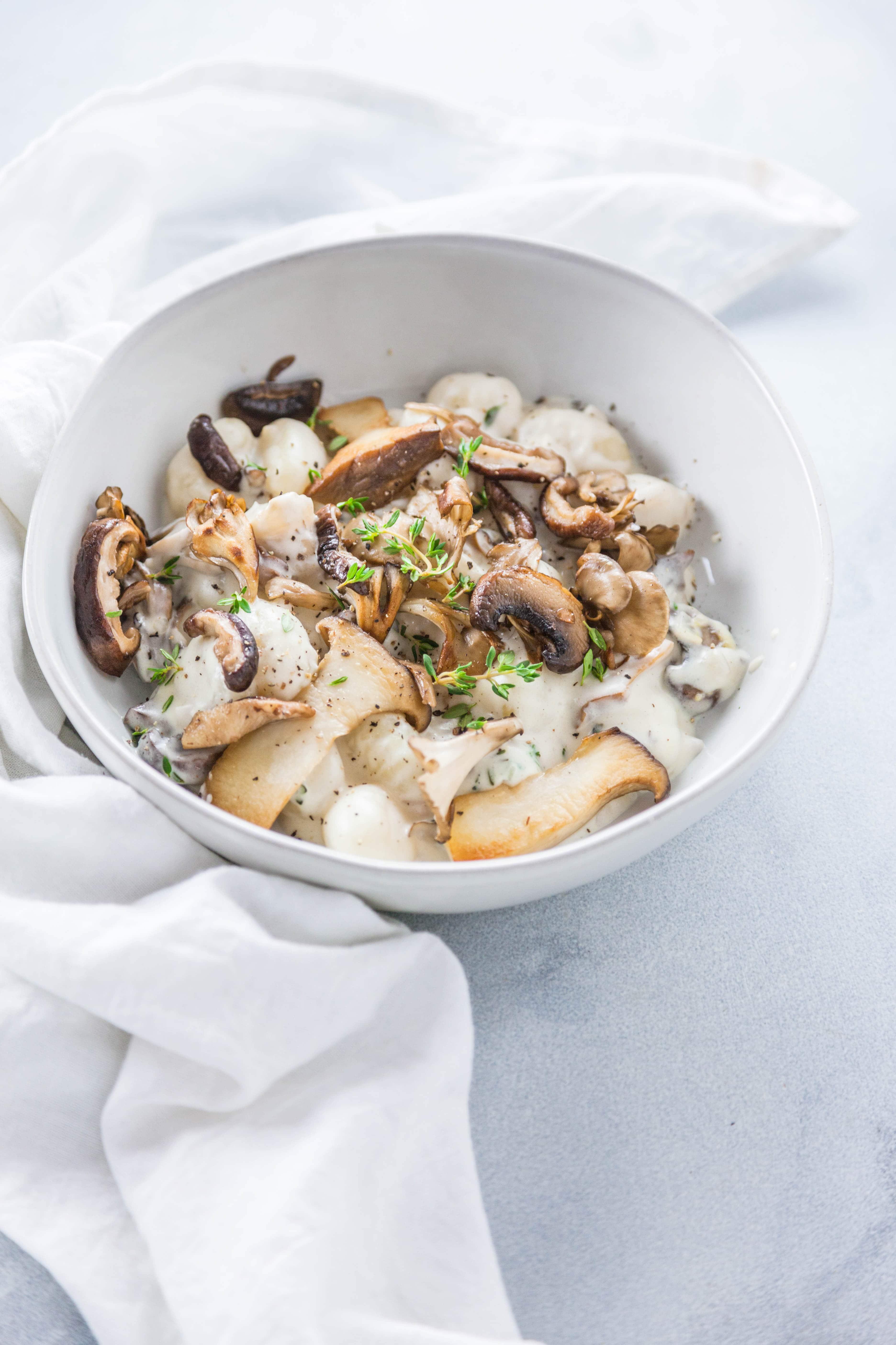 Creamy Mushroom Gnocchi in a white bowl.