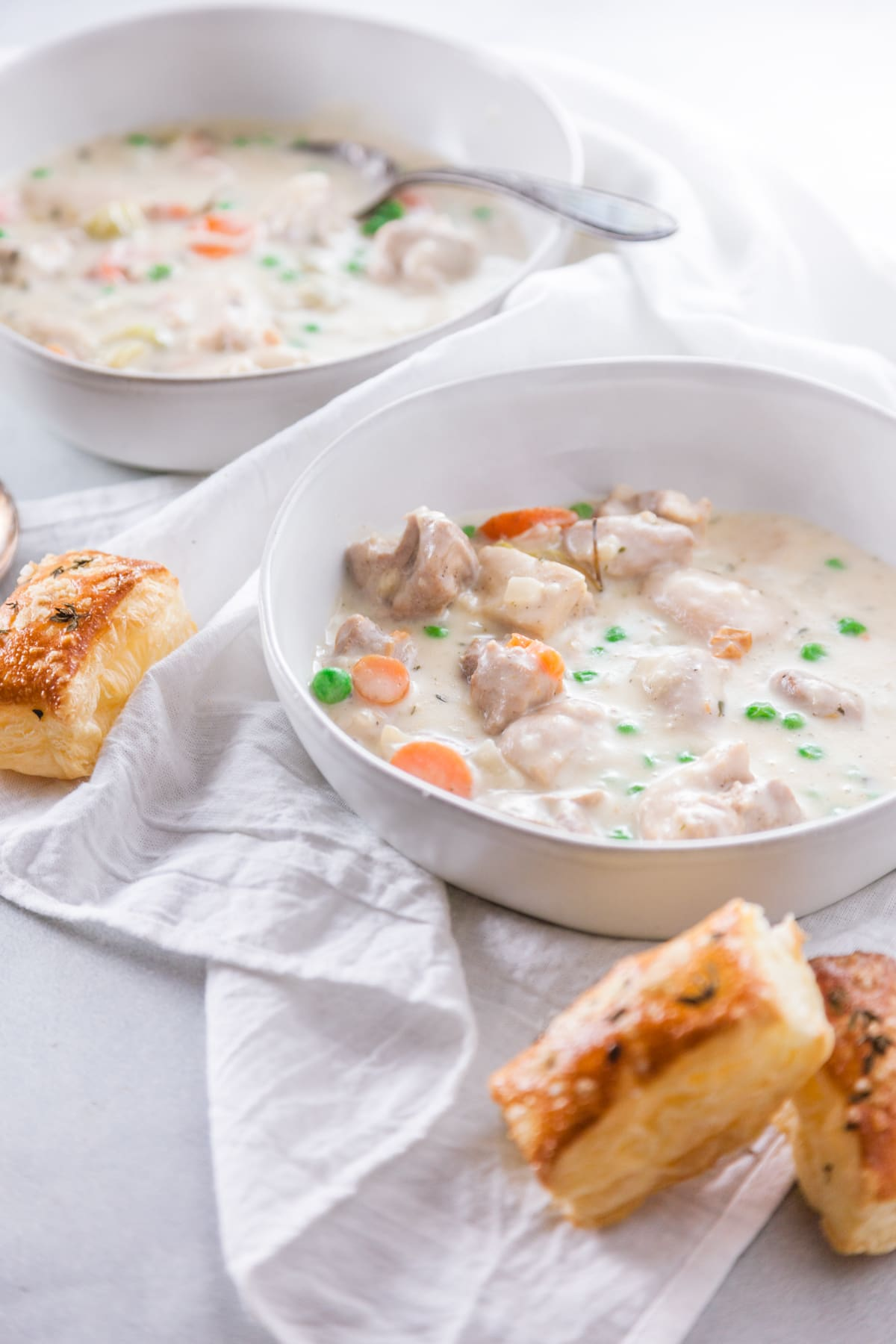 two white bowls full of Easy Stovetop Chicken Pot Pie with croutons.