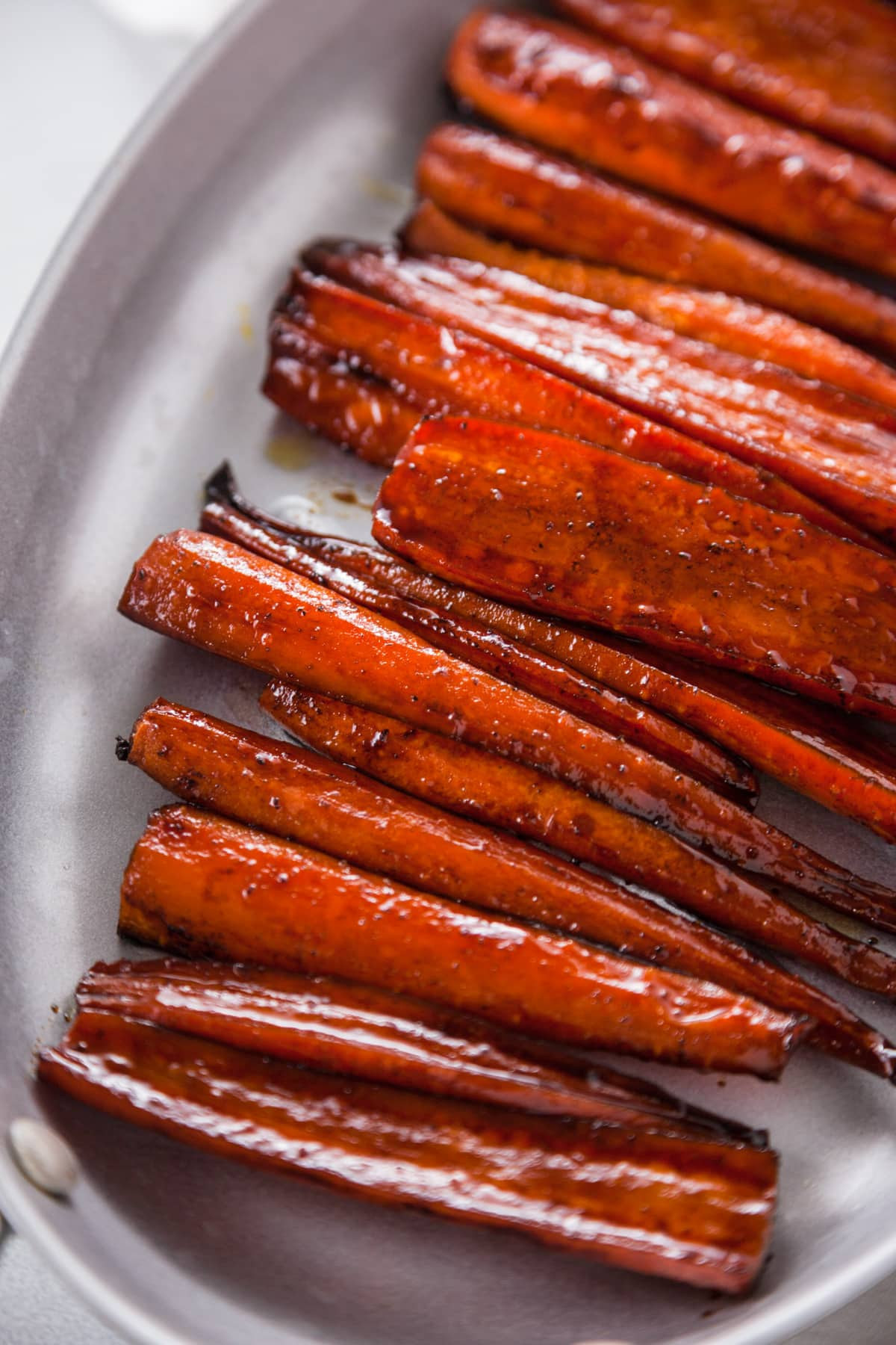 a close up shot of Balsamic Glazed Roasted Carrots.