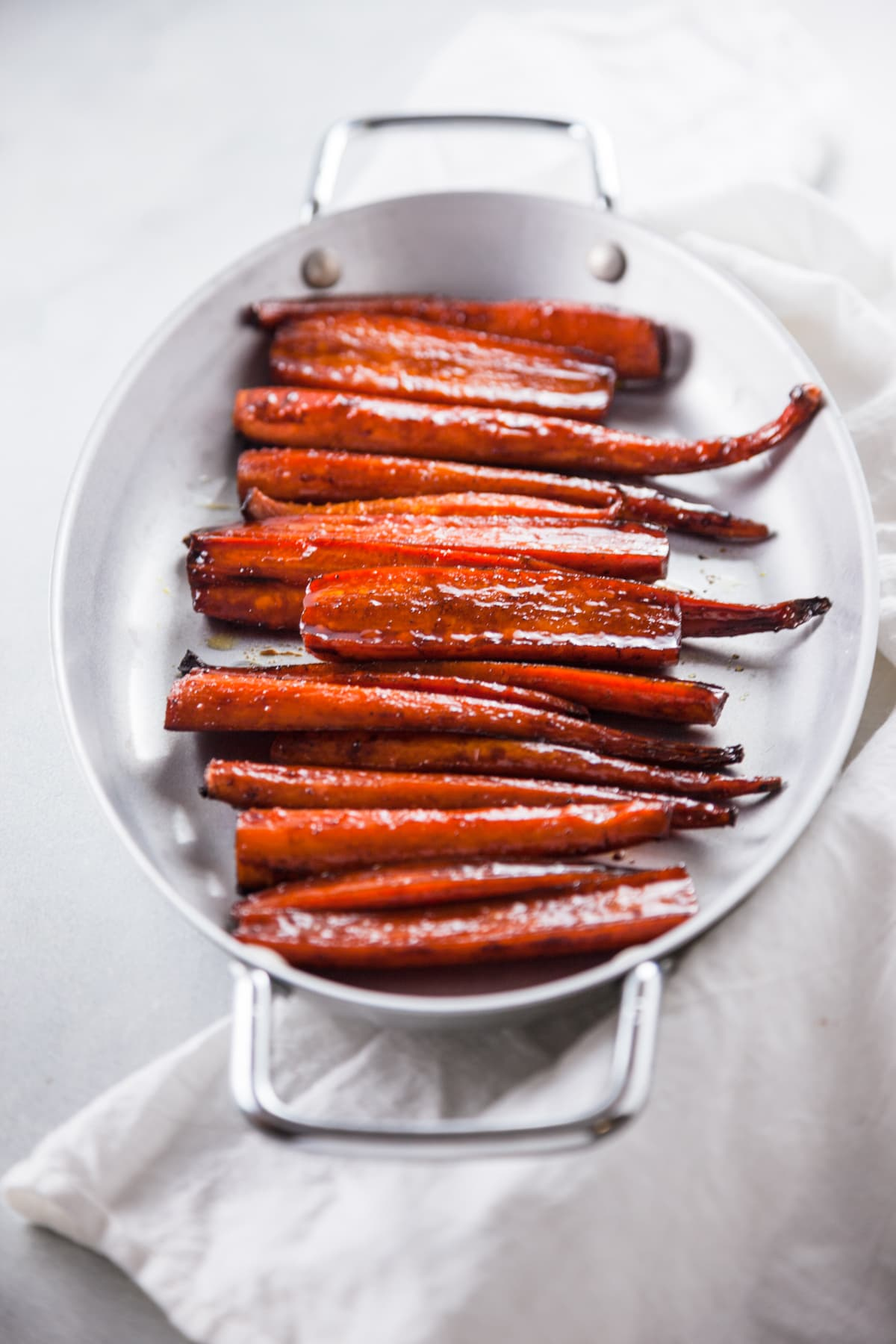 Balsamic Glazed Roasted Carrots in a silver tray.