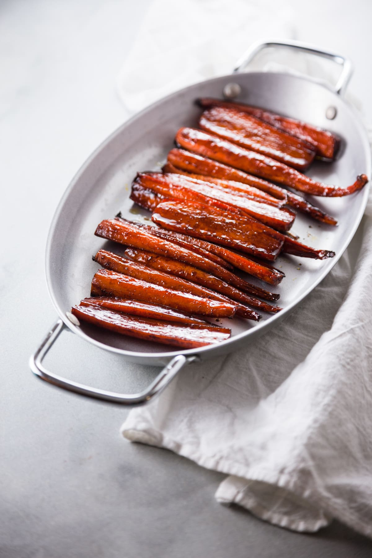 Balsamic Glazed Roasted Carrots in a silver dish.