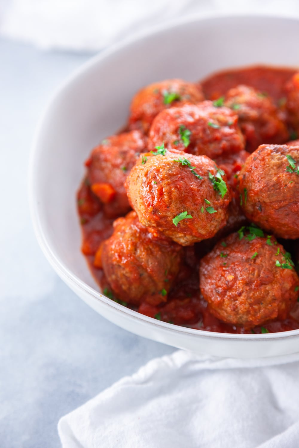 Italian Meatballs with Red Sauce in a white bowl.
