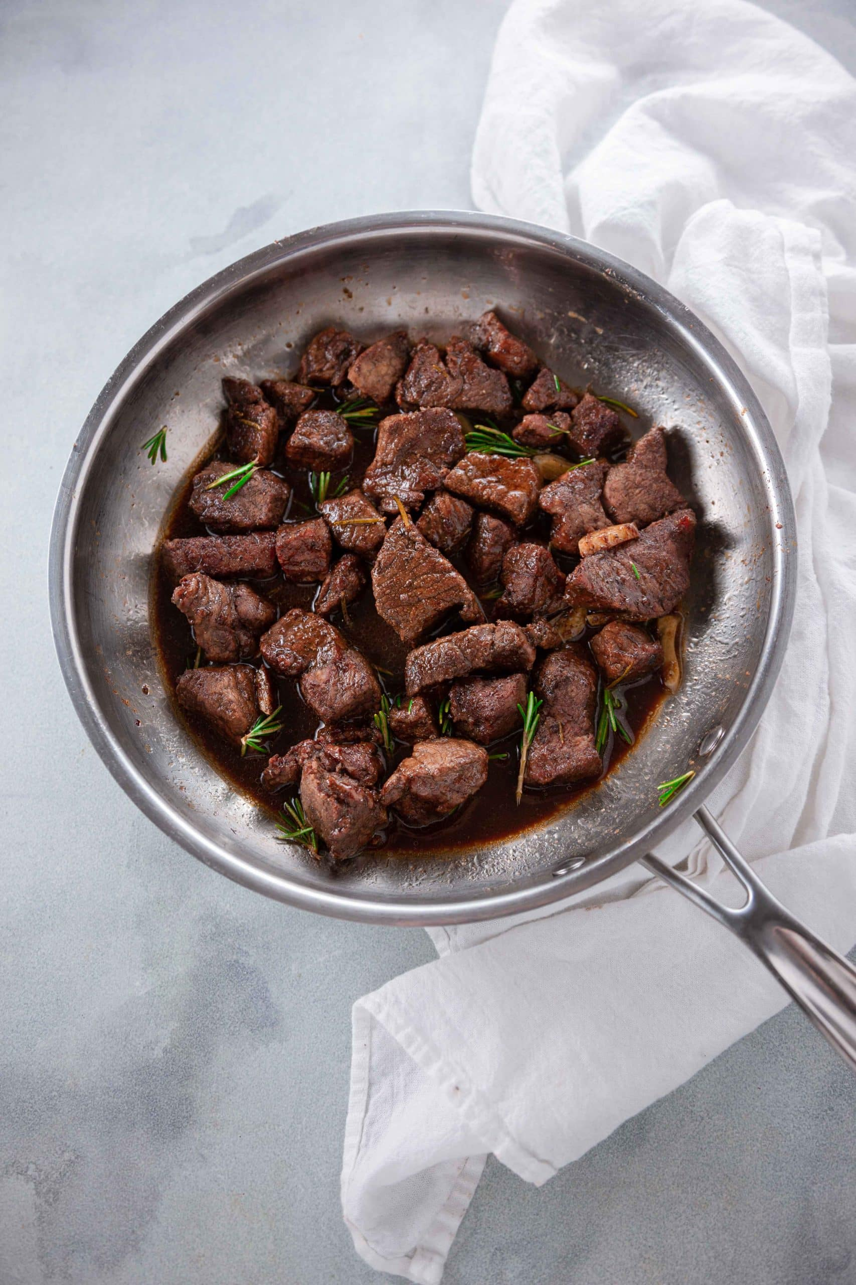 Rosemary Balsamic Steak Tips from overhead in a silver pan.