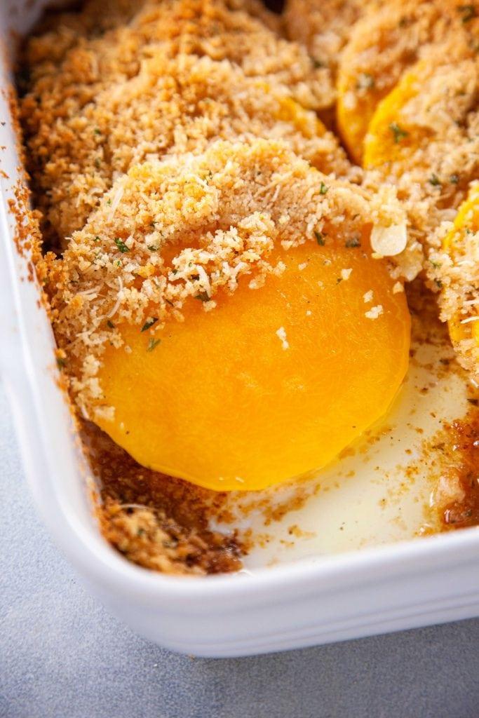 Butternut Squash Gratin in a white baking dish.