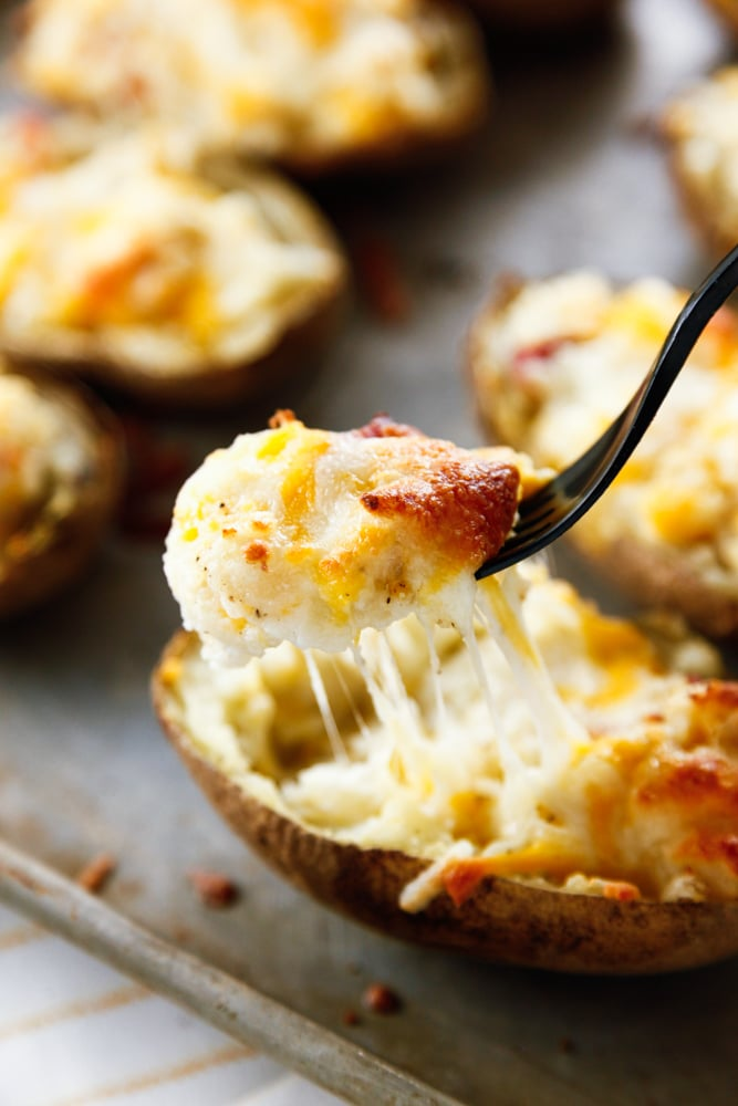 a forkful of Cheesy Twice Baked Potatoes.