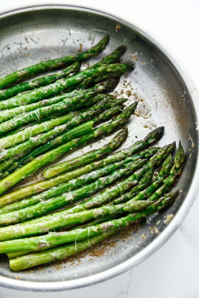 Brown Butter Parmesan Asparagus in a silver skillet.