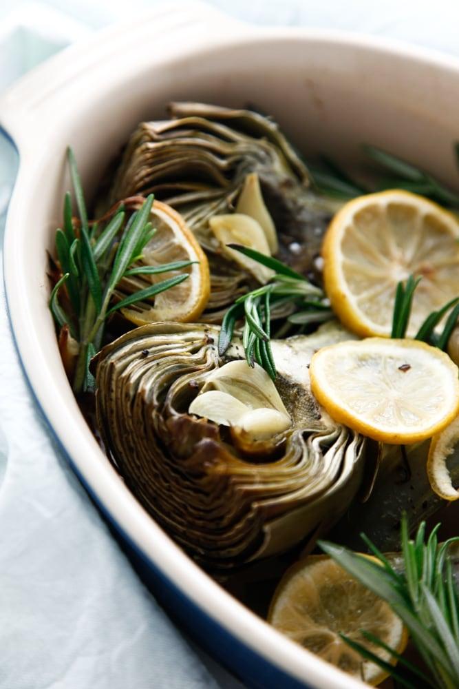 Lemon Rosemary Baked Artichokes in a baking dish.