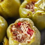 pinterest image for baked stuffed bell peppers.
