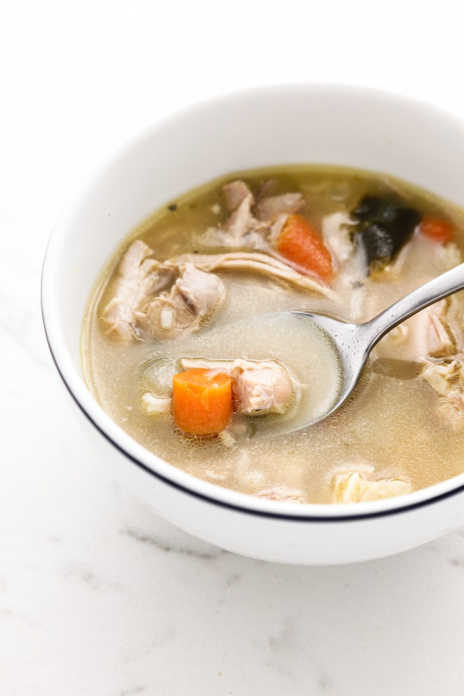 Classic Turkey and Rice Soup in a white bowl.