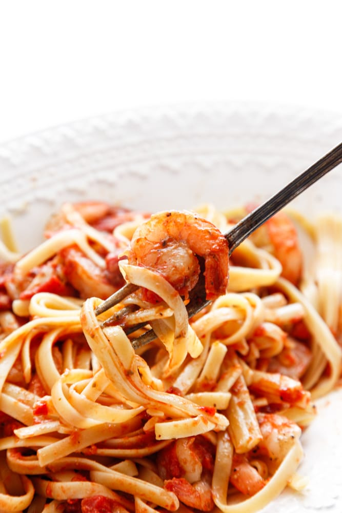 a forkful of Spicy Shrimp Fra Diavolo.