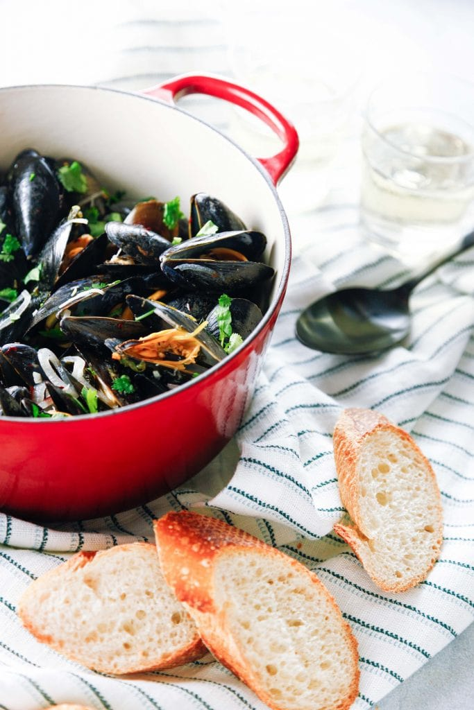 Steamed Mussels in White Wine in a red dutch oven.