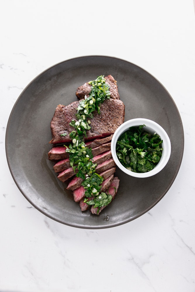 Rustic Chimichurri London Broil from overhead on a palte.