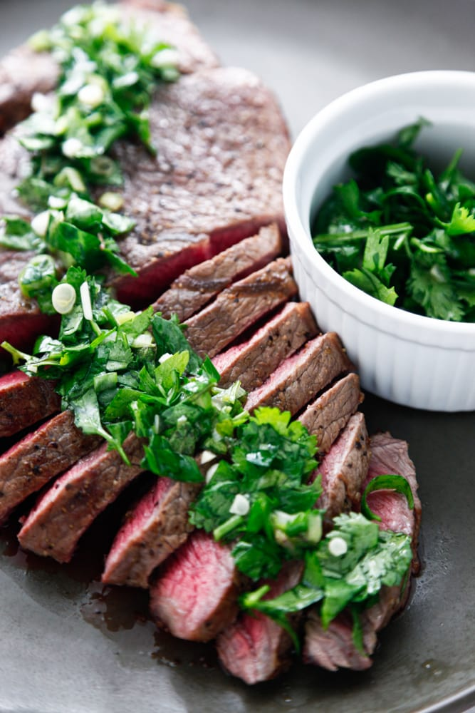 Rustic Chimichurri London Broil on a plate.