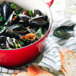 Pinterest image for mussels in white wine.