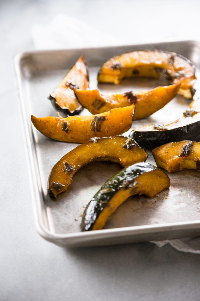 A silver tray of Honey Sage Roasted Squash.