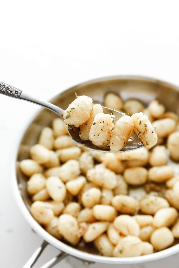 Brown Butter Gnocchi in a silver skillet.