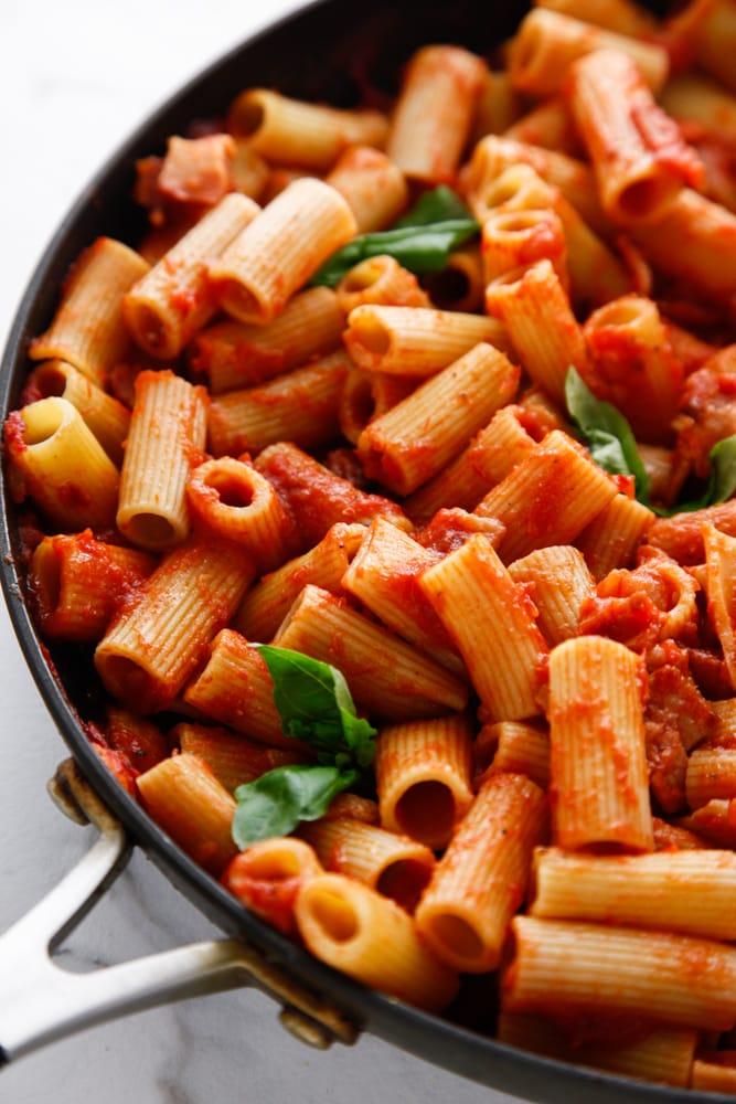 Saucy Bacon Tomato Rigatoni in a skillet.