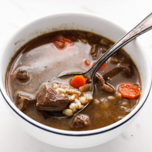 category image for soups, photo of beef and barley soup and a silver spoon